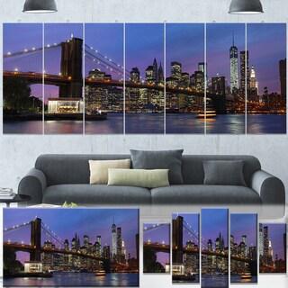 Designart 'Brooklyn Bridge and Manhattan at sunset' Extra Large Cityscape Wall Art on Canvas - Purple