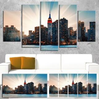 Designart 'Manhattan Skyline at Bright Sunset' Extra Large Cityscape Wall Art on Canvas