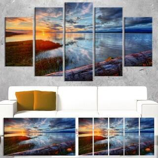 Designart 'Colorful River Sunset With Log' Seashore Art Print on Canvas