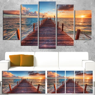 Designart 'Sunset over Wooden Sea Pier' Modern Bridge Canvas Wall Art