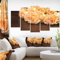 Designart 'Roses on Wooden Surface Photo' Floral Canvas Artwork Print - White