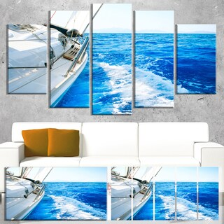 Designart 'White Sailing Yacht in Blue Sea' Large Seashore Canvas Wall Art