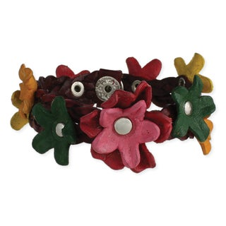 Braided leather bracelet with colorful leather flowers throughout.