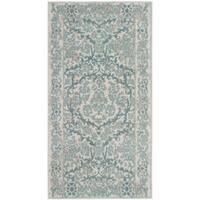 Safavieh Evoke Vintage Oriental Ivory / Light Blue Distressed Rug - 2'2 x 4'