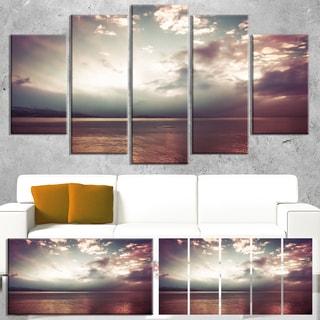 Designart 'Dark Sunset with Dramatic Sky' Large Seashore Canvas Artwork Print