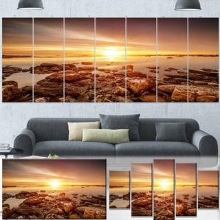 Designart 'Beautiful Sunset Over Rocky Beach' Large Seashore Canvas Artwork Print