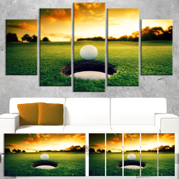 DesignArt 'Golf Ball Near Hole' Landscape Artwork Canvas Print - Green