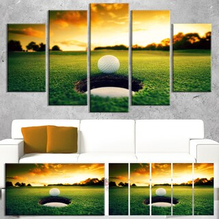 DesignArt 'Golf Ball Near Hole' Landscape Artwork Canvas Print - Green