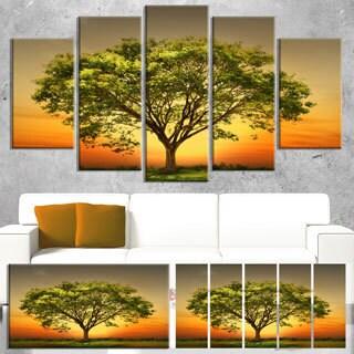Designart 'Green Tree against Setting Sun' Modern Trees Canvas Wall Art