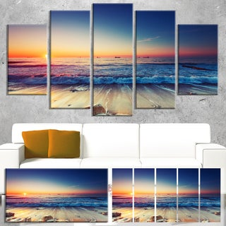 Designart 'Beautiful Sunrise over Blue Sea' Modern Seashore Canvas Wall Art Print