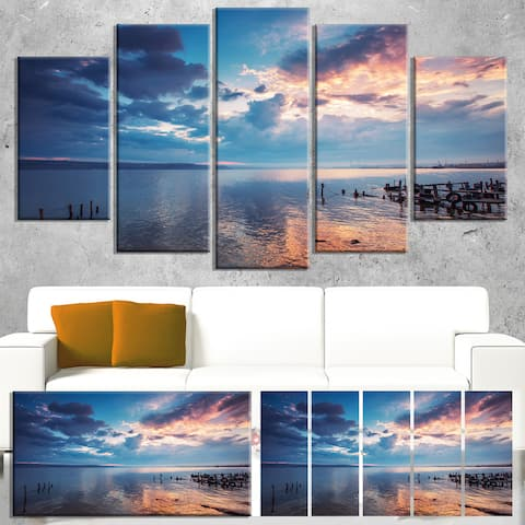 Designart 'Dramatic Sky Over Sunset Lake' Landscape Wall Art Print Canvas - Blue