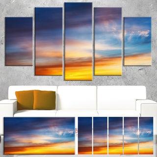 Designart 'Sunset Dramatic Yellow Sky Clouds' Modern Seashore Canvas Wall Art Print