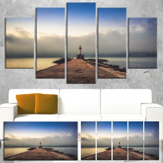 Designart 'Lighthouse on Coast and Cloudy Sky' Modern Bridge Canvas Wall Art
