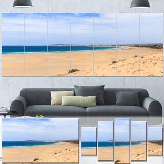 Designart 'Sea and Clouds in Blue Sky' Modern Seashore Canvas Wall Art Print