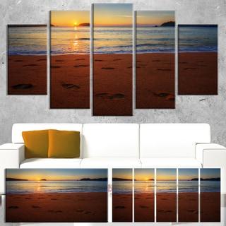Designart 'Foot printed Sandy Ocean Beach' Seashore Art Print on Canvas
