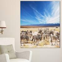 Designart 'Herd of Zebras under Blue Sky' African Canvas Artwork