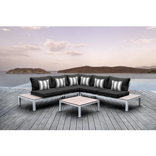 Solis Pulito 4-piece Outdoor Sectional White with Black Cushions and Grey and White Stripe Square Toss Pillows
