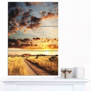 Designart 'Cloudy African Prairie with Pathway' Extra Large Landscape Canvas Art