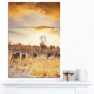 Designart 'African Zebras Walking in Row' Extra Large African Landscape Canvas Art