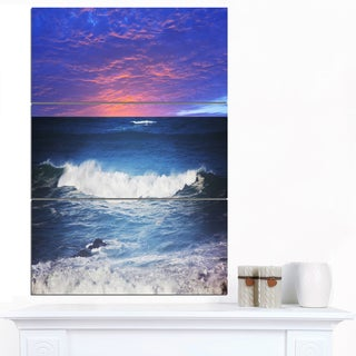 Designart 'Troubled Sunset Sea under Blue Sky' Seashore Canvas Art Print