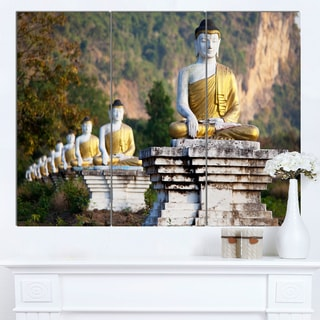 Designart 'Beautiful Row of Buddha Statues' Oversized Landscape Canvas Art