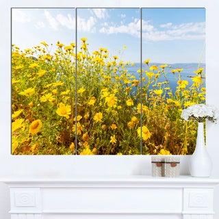 Designart 'Little Yellow Flowers over Seashore' Large Flower Wall Artwork