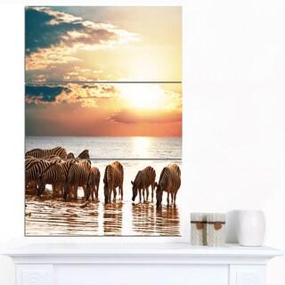 Designart 'Herd of Zebras in Clear Lake' African Art Canvas Print