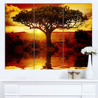 Designart 'Lonely Tree in African Sunset' Oversized African Landscape Canvas Art
