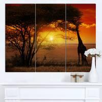 Designart 'Typical African Sunset with Giraffe' Oversized African Landscape Canvas Art