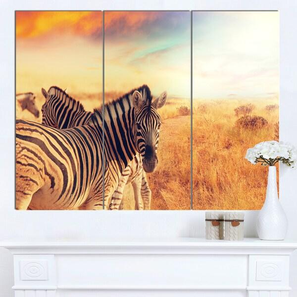 Designart 'Zebras Herd in Field At Sunset' Extra Large African Art Print - multi