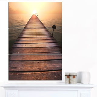 Designart 'Long Wooden Boardwalk into Sea' Large Seashore Canvas Art