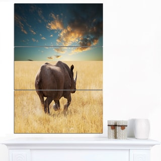 Designart 'Giant Rhino under Cloudy Sky' Extra Large African Art Print