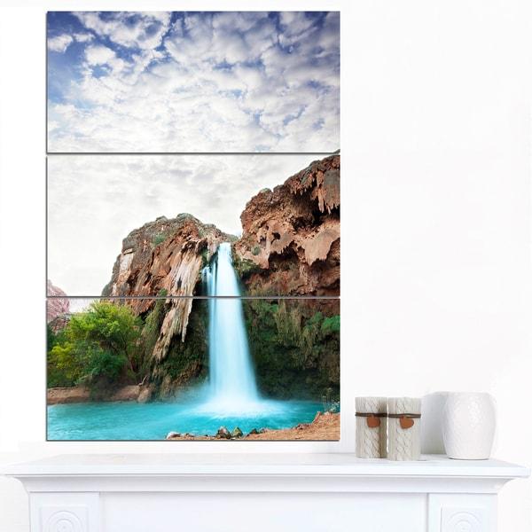 Designart 'Amazing Waterfall under Cloudy Sky' Oversized Landscape Canvas Art - multi