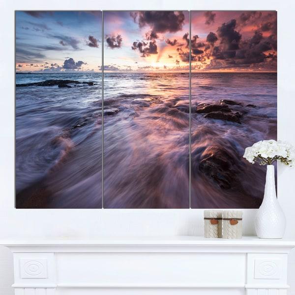 Designart 'Waves Hitting Rocky Beach' Beach Canvas Wall Art - multi