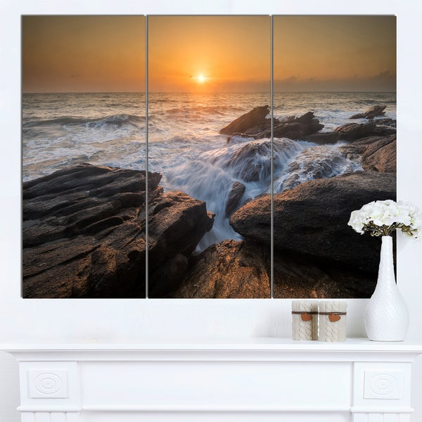 Designart 'Sunset over Rocky Seashore' Beach Canvas Wall Art - multi