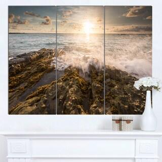 Designart 'Sea Waves Impact on Rocky Shore' Beach Canvas Wall Art