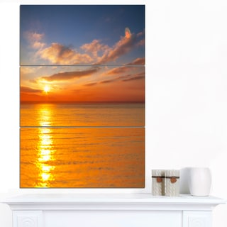 Designart 'Beautiful Sunset Reflecting in Sea' Large Seashore Canvas Print