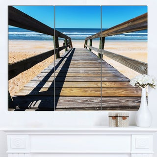 Designart 'Long Boardwalk into Blue Seashore' Large Seashore Canvas Art