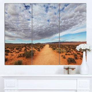 Designart 'Desert Road under Bright Cloudy Sky' African Landscape Print Wall Art