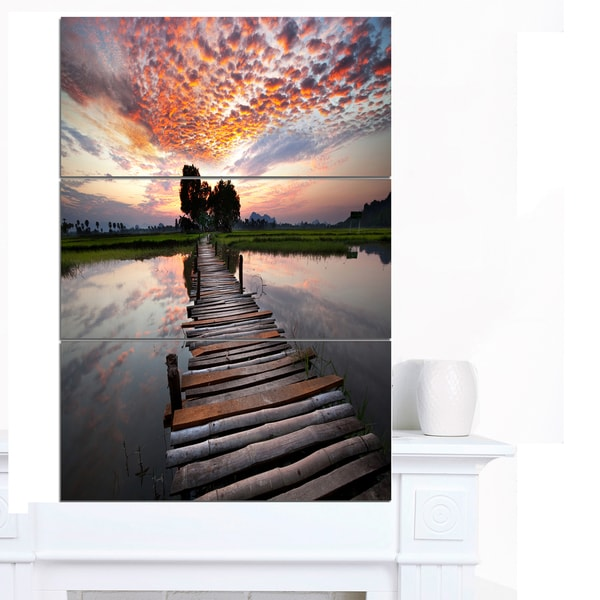 Designart 'Wooden Bridge under Dramatic Sky' Large Seashore Canvas Art
