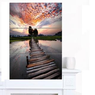 Designart 'Wooden Bridge under Dramatic Sky' Large Seashore Canvas Art