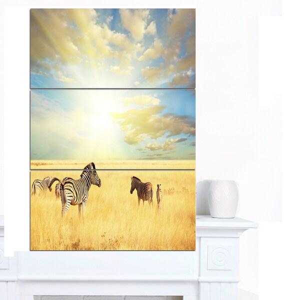 Designart 'Sunset over Grassland with Zebras' Extra Large African Landscape Canvas Art - Brown/Blue