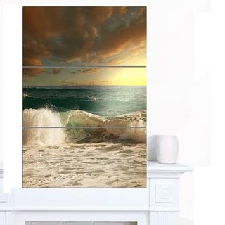 Designart 'Rushing Waves under Heavy Clouds' Beach Canvas Wall Art