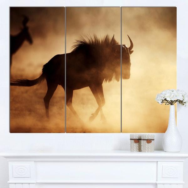 Designart 'Blue Wildebeest Running in Dust' African Canvas Artwork - Blue