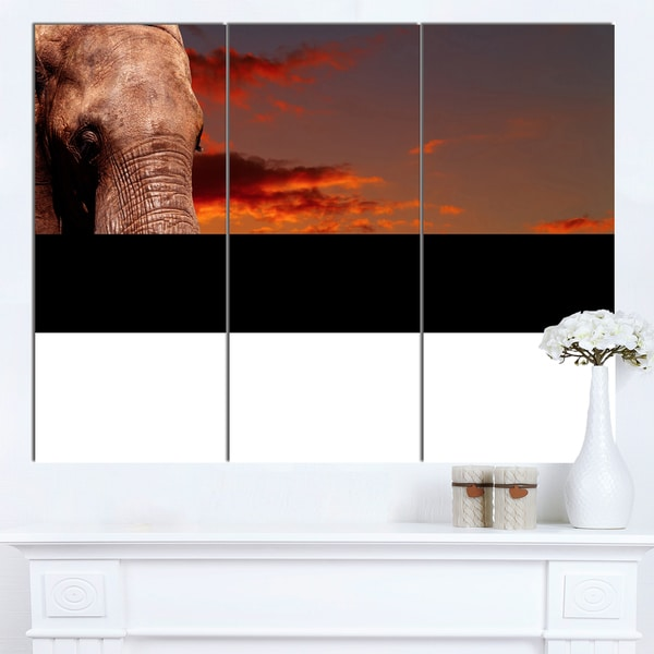 Designart 'African Elephant with Africans' African Wall Art Canvas Print