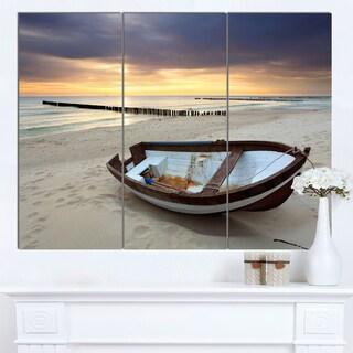 Designart 'Boat on Beautiful Sunrise Seashore' Large Beach Canvas Wall Art
