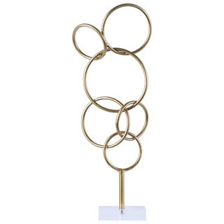 Urban Trends Collection Metallic Gold Finish Metal Cascading Interlooping Circles Sculpture on Square Acrylic Base