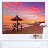 Designart 'Lifeguard Station in Beautiful Beach' Modern Seashore Canvas Art - Blue