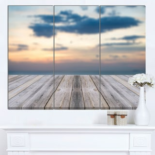 Designart 'Wooden Board at Sunset Seashore' Modern Bridge Canvas Wall Art