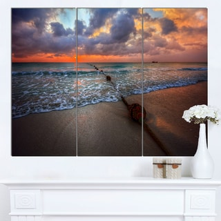 Designart 'Reddish Sunset over Clear Beach' Seashore Art Print on Canvas